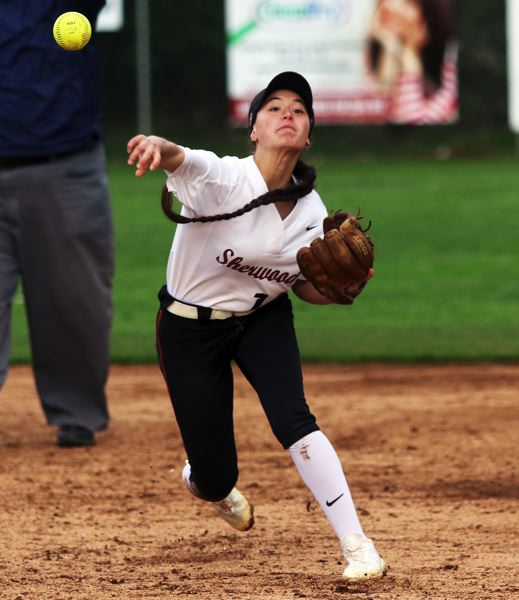 PMG PHOTO: DAN BROOD - Sherwood sophomore shortstop McKenzie Abiley makes a throw to first base during the Lady Bowmen's 11-0 win over Gresham.