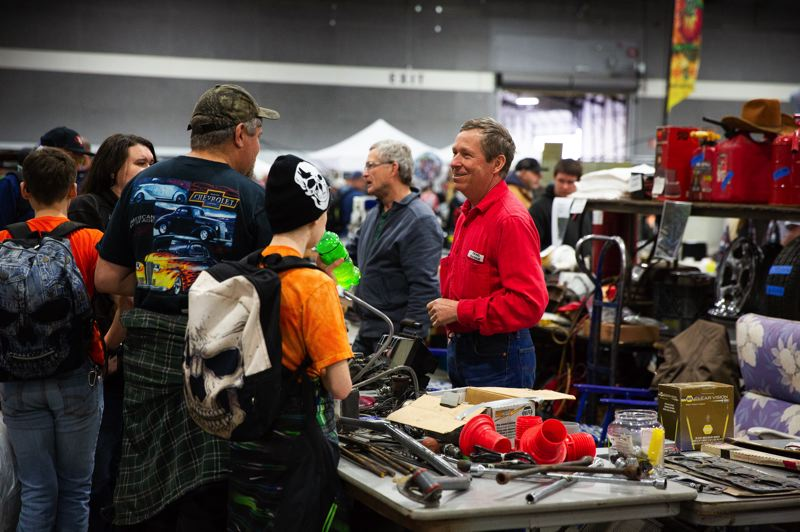 PMG PHOTO: ADAM WICKHAM - Craig Savage chatted with customers at the swap meet at the Portland Expo Center.
