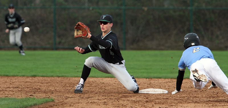 PMG PHOTO: MILES VANCE - Tigard junior infielder Ethan Clark waits for the ball during the Tigers 5-3 win at Lakeridge on April 3.