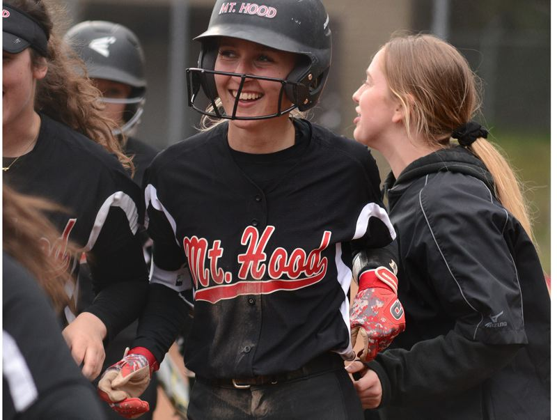 PMG PHOTO: DAVID BALL - Mt. Hoods Kathryn Bradford is greeted at the plate after hitting a two-run homer to put the Saints up 6-2 early in Game 2 against Chemeketa on Tuesday.