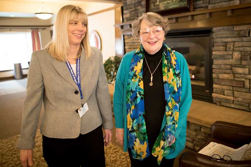 PMG PHOTO: JAIME VALDEZ - Kim Arabia, who is the certified volunteer in Wilsonville for the states long-term care ombudsman program, visits with Bev White, a resident at The Springs at Wilsonville.