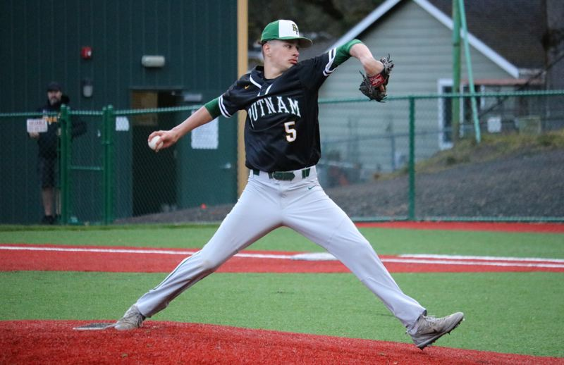 PMG PHOTO: JIM BESEDA - Putnam's Austin Keel needed only 10 pitches to work through a scoreless seventh inning as the Kingsmen nailed down a 5-4 Northwest Oregon Conference home win Tuesday over Scappoose.