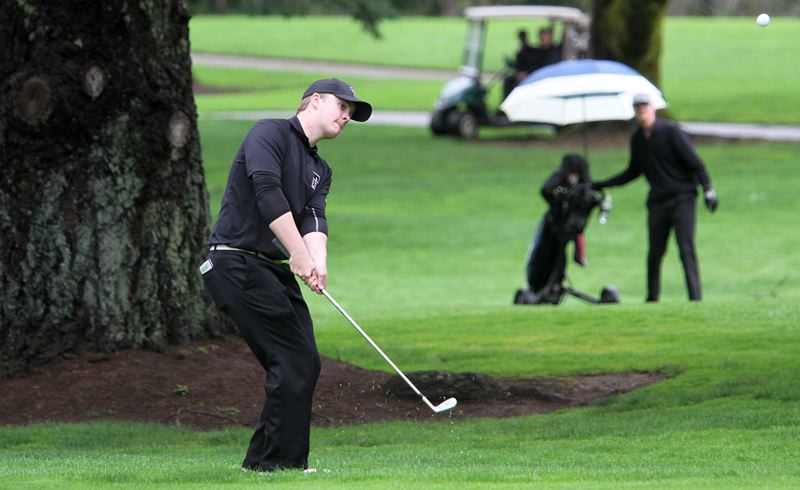 PMG PHOTO: MILES VANCE - Tualatin High School junior Bryce Hatcher chips onto the green during play at Monday's Three Rivers League boys golf tournament at Oswego Lake Country Club. Hatcher claimed medalist honors at the event.