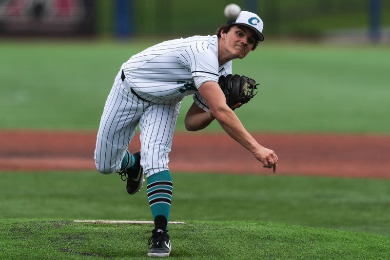 PMG PHOTO: CHRISTOPHER OERTELL - Century's Jared Gordon delivers during his team's game against Glencoe at Ron Tonkin Field in Hillsboro on Thursday, April 4.