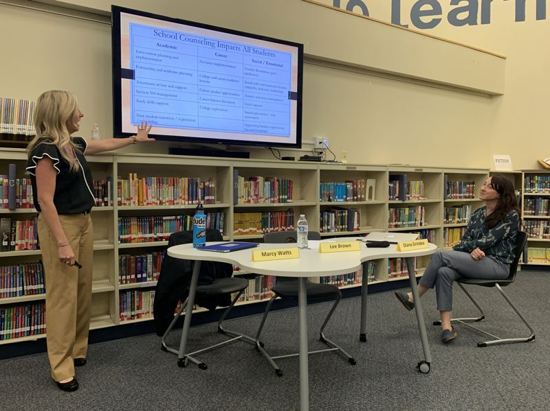 PMG PHOTO: CLAIRE HOLLEY - Lakeridge Junior High counselor Marcy Watts (left) explains middle school counseling at Tuesday's meeting. Right: Oak Creek counselor Diana Grindea-Thompson