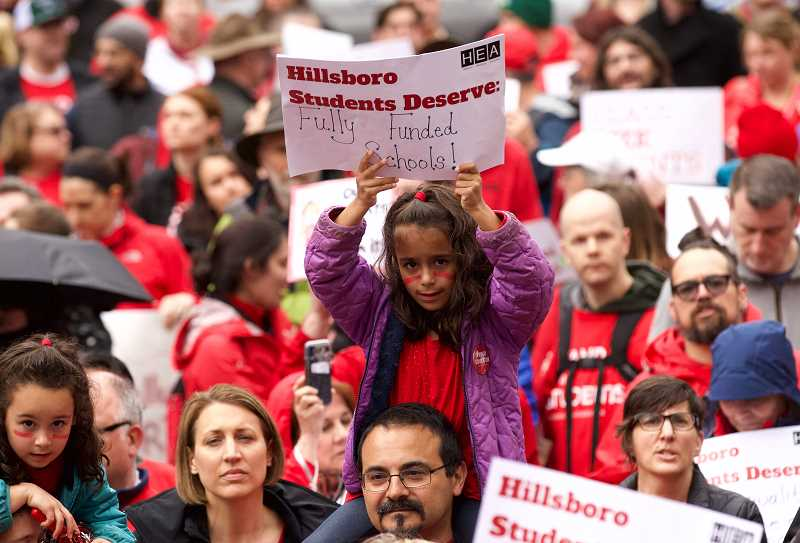 PMG PHOTO: JAIME VALDEZ - Teachers and students gather at Pioneer Courthouse Square with signs and banners to rally for better education funding from the Oregon State Legislature Wednesday, April 10.