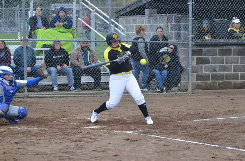 COURTESY PHOTO: JOHN BREWINGTON - St. Helens senior infielder Madi Flores takes a cut during the team's Northwest Oregon Conference opener on Tuesday at home against Hillsboro.