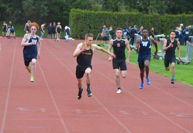 PMG PHOTO; JOHN BREWINGTON - Logan Page (second from left) gives St. Helens first place in the boys 100-meter dash Wednesday at Scappoose High.