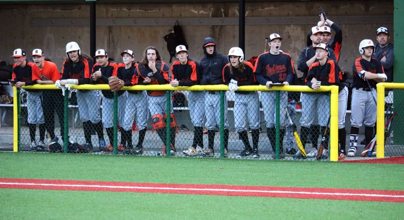 PMG PHOTO: JIM BESEDA - The Scappoose High baseball team gets into the game as the Indians hang with host Putnam on Tuesday.