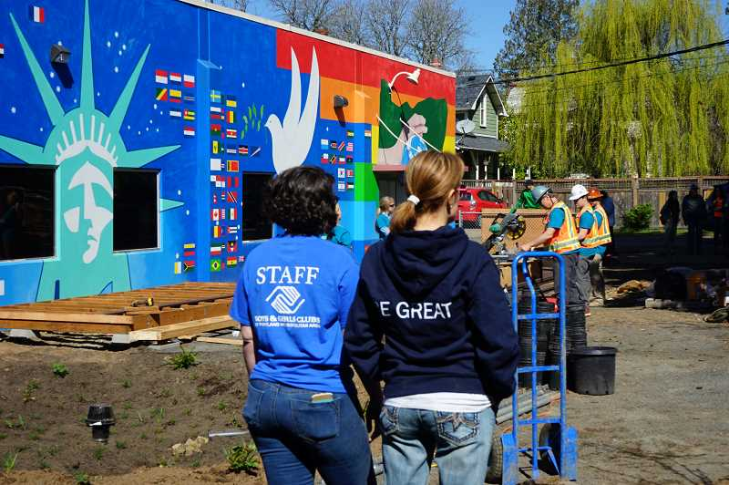 Boys & Girls Club staff at Inukai Family Club in Hillsboro supervise as crews build a new outdoor play space. The public is invited to its grand opening on Friday, April 12.