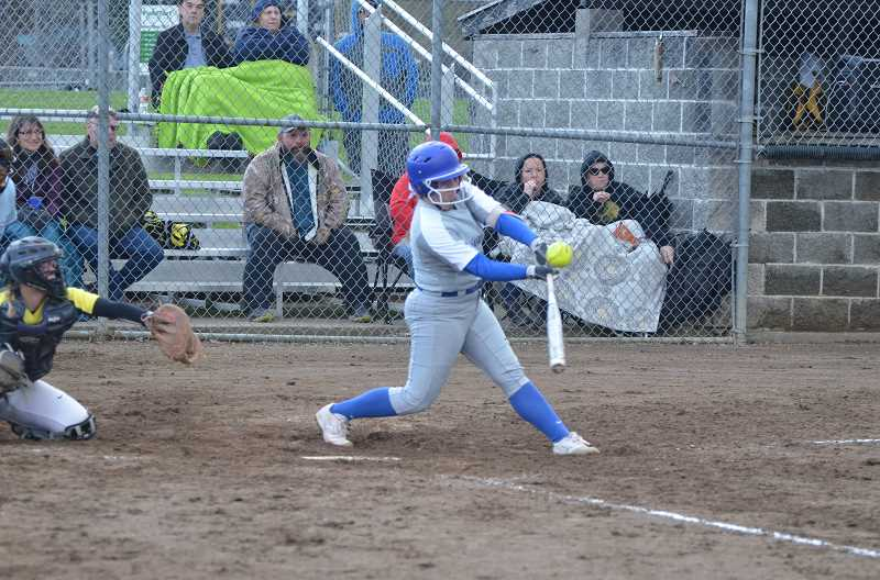 COURTESY PHOTO: JOHN BREWINGTON - Hillsboro's Natalee Dold takes a cut during the Spartans' game against St. Helens Tuesday, April 9, at St. Helens High School.