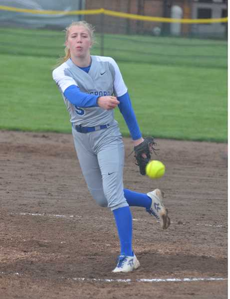 COURTESY PHOTO: JOHN BREWINGTON - Hillsboro's McKenzie Staub throws a pitch during the Spartans' game against St. Helens Tuesday, April 9, at St. Helens High School.