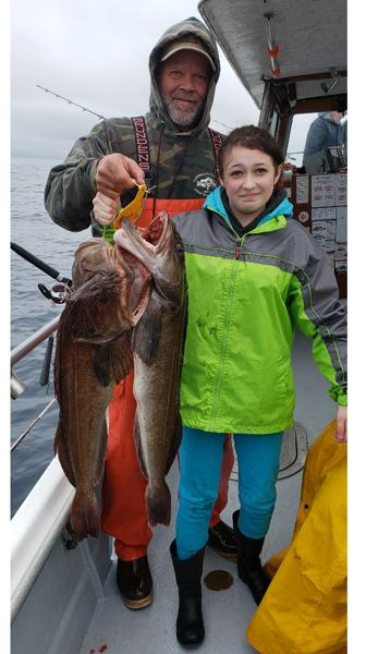 Captain Rob Gerlitz of Garibaldi Charters with a limit of large lingcod caught on Monday, April 1, pictured with Emma Duddles of Seaside, OR.