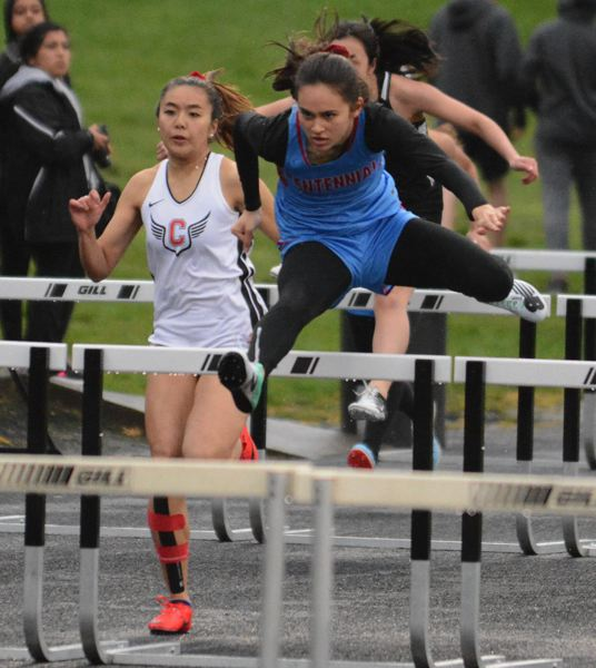 PMG PHOTO: DAVID BALL - Centennials Maddie McHone breaks away from the pack early in the high hurdles.