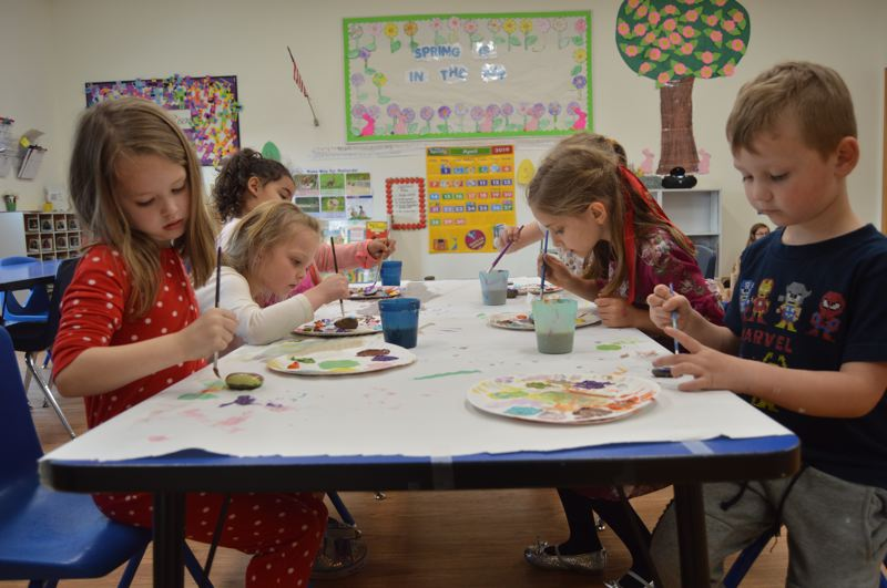 PMG PHOTO: NICOLE THILL-PACHECO - Students work on painting rocks at Grace Christian Childcare Center on Wednesday, April 10, for the kindness stream at Grant Watts Elementary School. Pictured from left to right are Abigail, Cora, Jenna, Georgia, Iman and Landon, who are all kindergarteners or first-graders at Grant Watts Elementary, Warren Elementary or Sauvie Island schools.
