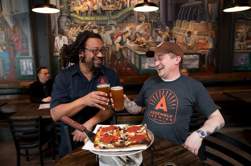 PAMPLIN MEDIA GROUP: JAIME VALDEZ - George Johnson, left, and Adam Dixon opened Assembly Brewing on Southeast Foster Road after realizing the area was lacking a pub-like space for adults in the neighborhood to gather.