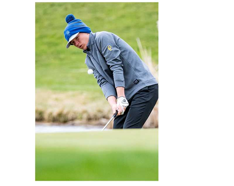 LON AUSTIN/CENTRAL OREGONIAN - Hogan Smith plays a ball out of the rough from near a water hazard last Friday at Meadow Lakes Golf Course. Smith shot a round of 102 on Monday as the Cowboys were fourth at the first IMC tourney  of the year.