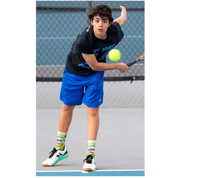 LON AUSTIN/CENTRAL OREGONIAN - Pablo Casado follows through after a serve in a match earlier this year. Casado was the lone Cowboy winner on Tuesday against the Redmond Panthers.