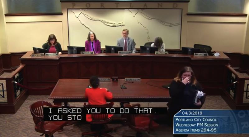 SCREENSHOT - Housing analyst Jessica Greenlee, right, leaves the testimony table after a heated encounter at Portland City Hall on April 3
