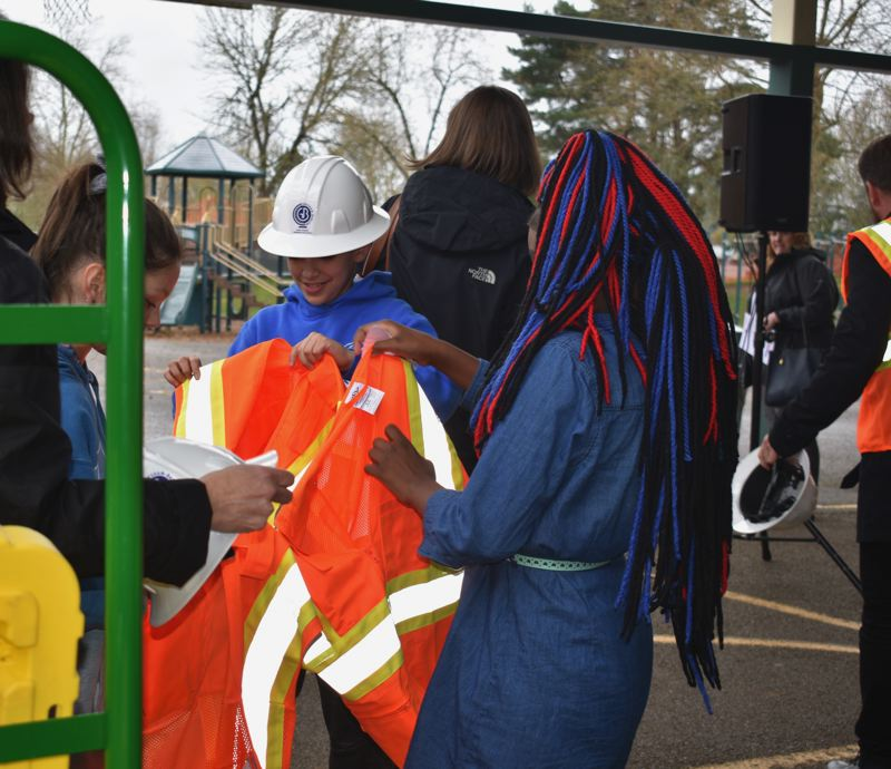 PMG PHOTO: TERESA CARSON - The Hall students get their gear on to head to the construction site.