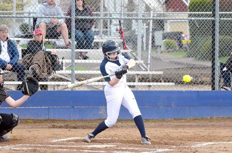 PMG PHOTO: TANNER RUSS - Frehsman Abigail Loomis cracks a pitch from Tualatin. Canby lost 14-4 in the first league matchup.