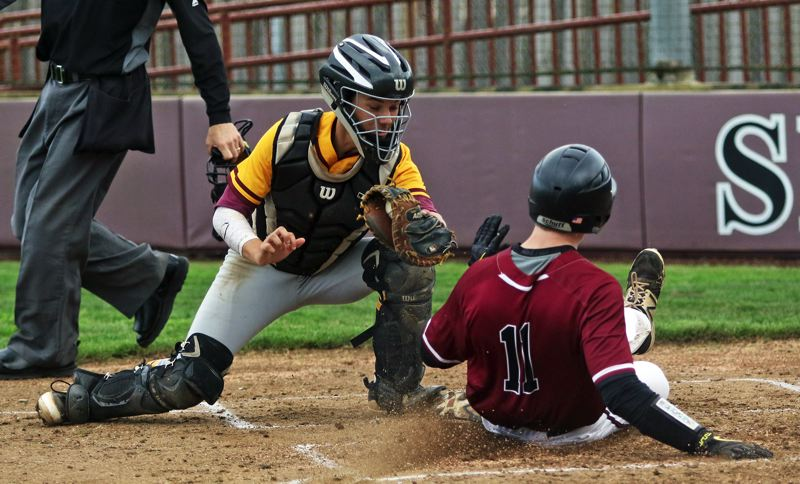 PMG PHOTO: DAN BROOD - Sherwood senior Sage Dunaway (right) slides safely to home plate before Forest Grove junior Max Richards can make a tag during Friday's Pacific Conference game.