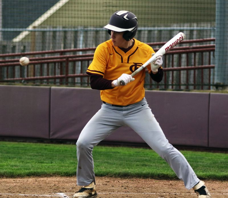 PMG PHOTO: DAN BROOD - Forest Grove junior Rhett Larson pulls his bat back on a bunt attempt during the Vikings' game at Sherwood on Friday.