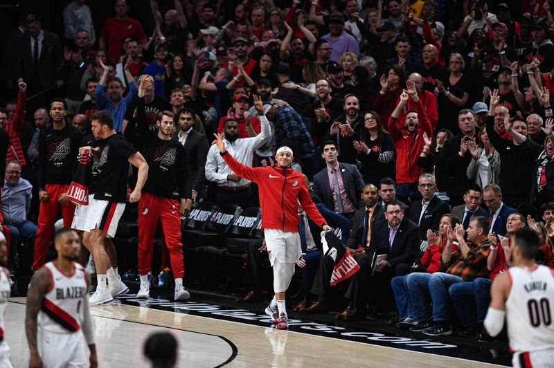 PMG: CHRISTOPHER OERTELL - The Trail Blazers bench and fans cheer as Portland scores en route to its 104-99 victory over the Oklahoma City Thunder on Sunday afternoon at Moda Center. Portland took a 1-0 lead in the best-of-seven playoff series to be continued Tuesday night.