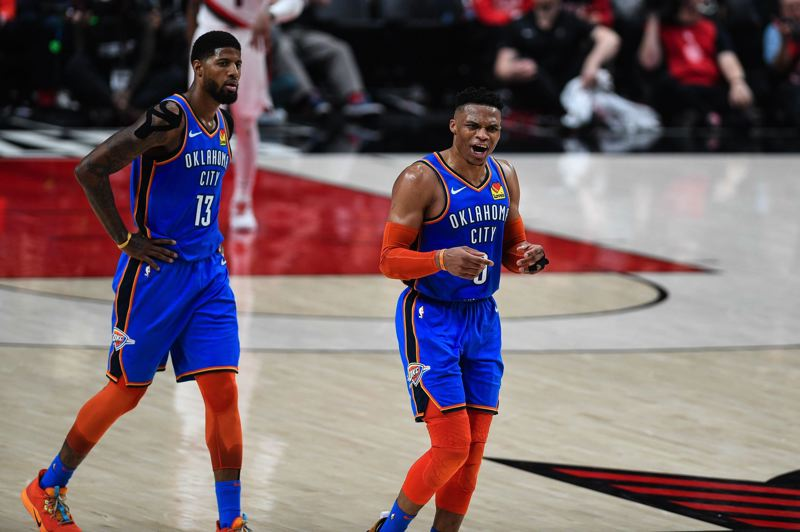 PMG PHOTO: CHRISTOPHER OERTELL - Russell Westbrook (right) of the Oklahoma City Thunder reacts to a call on Sunday at Moda Center.