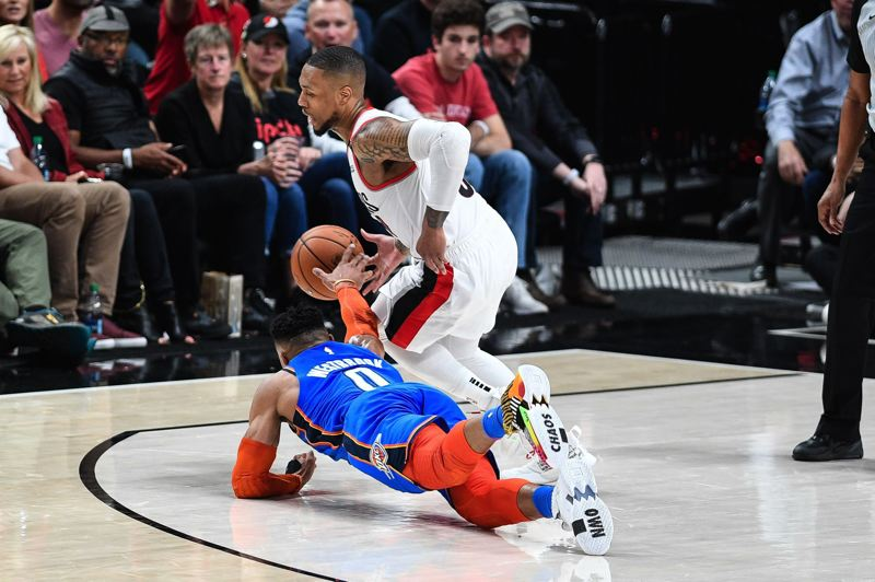 PMG PHOTO: CHRISTOPHER OERTELL - Trail Blazers guard Damian Lillard (right) and Oklahoma City's Russell Westbrook fight for the ball during Sunday's Game 1 of their NBA playoff series at Moda Center.