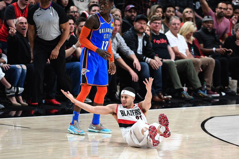 PMG PHOTO: CHRISTOPHER OERTELL - Seth Curry of the Trail Blazers reacts to a foul call on a play with Dennis Schroder of Oklahoma City during Game 1 of their NBA playoff series Sunday at Moda Center.