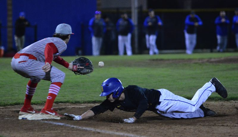 PMG PHOTO: DAVID BALL - Barlows Carter Loeb dives safely back to first base, while Centennials Landan Fery prepares to make the catch. The Bruins swept Fridays doubleheader.