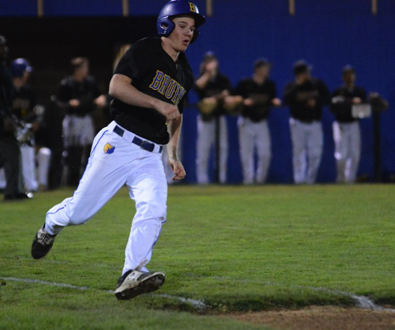PMG PHOTO: DAVID BALL - Barlows Titus Dumitru rounds first base with a double to lead off the second inning.