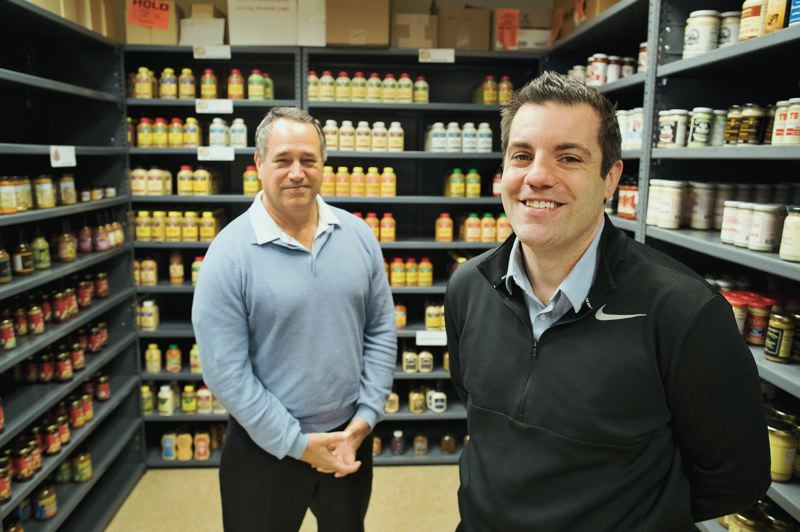 PAMPLIN MEDIA GROUP: JAIME VALDEZ - Domonic Biggi, left, CEO of Beaverton Foods, and his nephew, Jeff Biggi, the companys food service sales manager, are the third and fourth generations in the 90-year-old family business that Rose Biggi started in Beaverton in 1929.