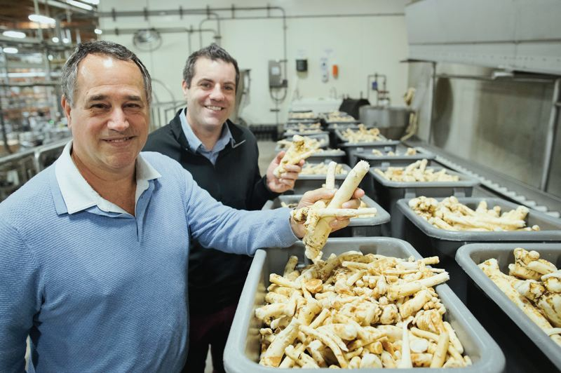PAMPLIN MEDIA GROUP: JAIME VALDEZ - Domonic Biggi, left, CEO of Beaverton Foods, and his nephew, Jeff Biggi, the company's food service sales manager, are the third and fourth generations in the 90-year-old family business that Rose Biggi started in Beaverton in 1929.