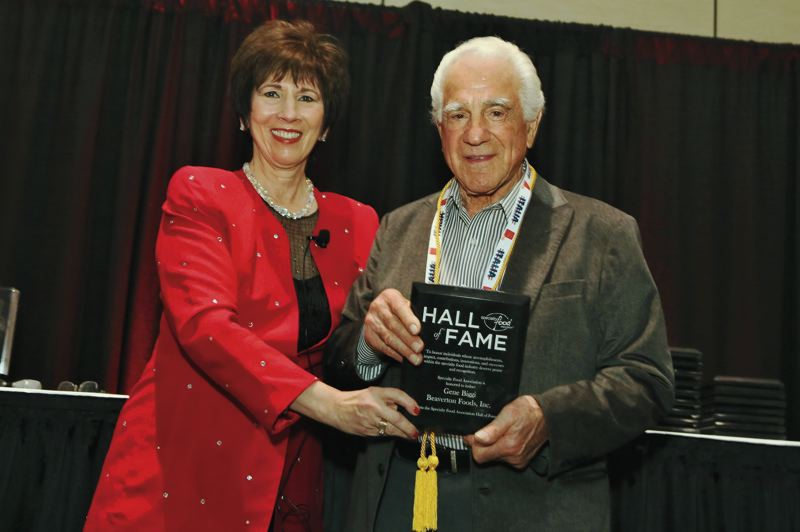 COURTESY: BEAVERTON FOODS - Known as the Maestro of Mustard, Gene Biggi, right, chairman of the board at Beaverton Foods, was honored in 2016 with a spot in the Specialty Food Associations Hall of Fame.
