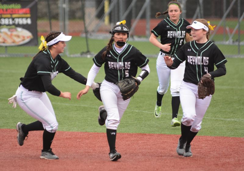 PMG PHOTO: DAVID BALL - Reynolds infielder Vanessa Smoke (5) is congratulated by teammates after getting the third out in an inning during the teams 8-7 win in Sandy on Friday.