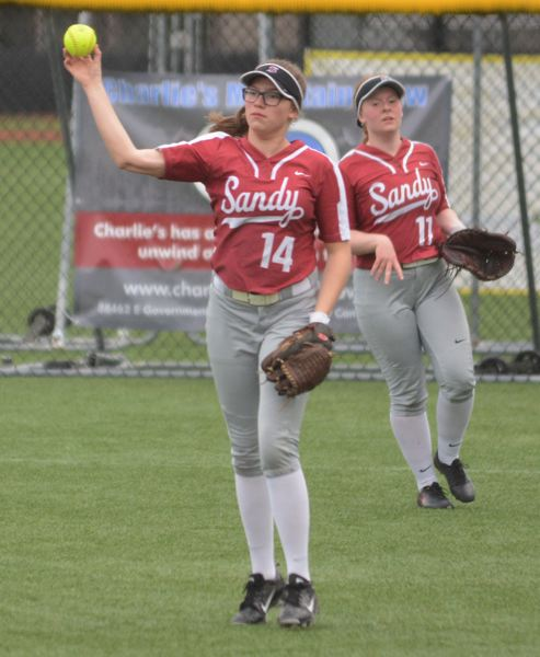 PMG PHOTO: DAVID BALL - Sandys Haylee Lutz returns the ball after making a third out in the outfield.