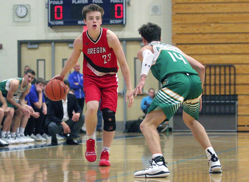 PMG PHOTO: MILES VANCE - Lake Oswego's Josh Angle also helped handle the ball for the Oregon team at Northwest Shootout on Saturday, April 13, at Liberty High School.