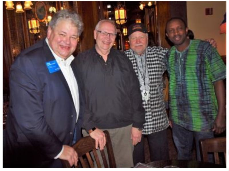 COURTESY PHOTO - From right, Brikama Society member Lamin Jallow, is introduced by Rotarian Ed Gronke to Tom Markos, Rotary Foundation district chair, and Dick Elixman, global grant chair for the district.