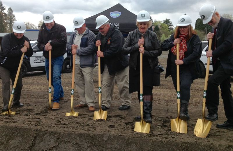 COURTESY PHOTO - Gladstone Mayor Tammy Stempel and City Council members Matt Tracy, Randy Ripley, Neal Reisner, Linda Neace, Tracy Todd and Thomas Mersereau (from left) donned hardhats and took up golden shovels to break ground on the new civic center.