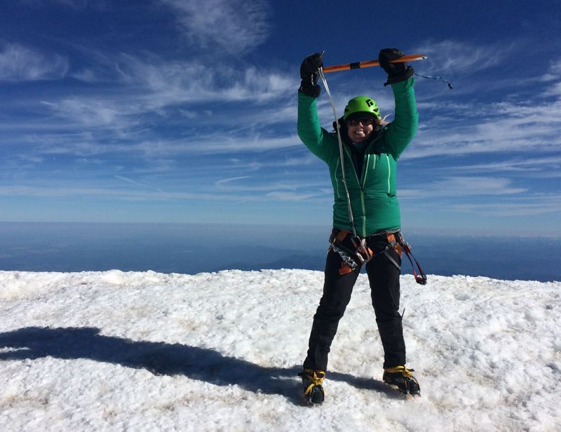 COURTESY: KIM OSGOOD - Kim Osgood celebrates a momentous occasion atop Mount Rainier, finishing and earning the '16 Major Northwest Peaks Award' from the Mazamas climbing club.