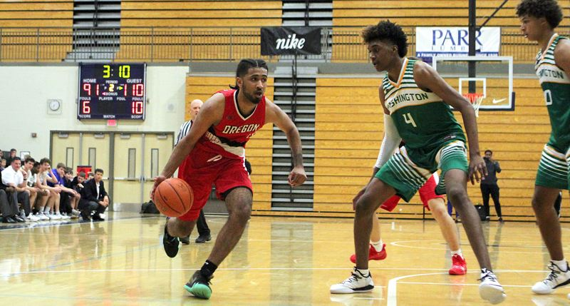 PMG PHOTO: MILES VANCE - Marcus Tsohonis (left) from Jefferson High starts to drive for the Oregon all-star team in its Northwest Shootout game against Washington at Liberty High.