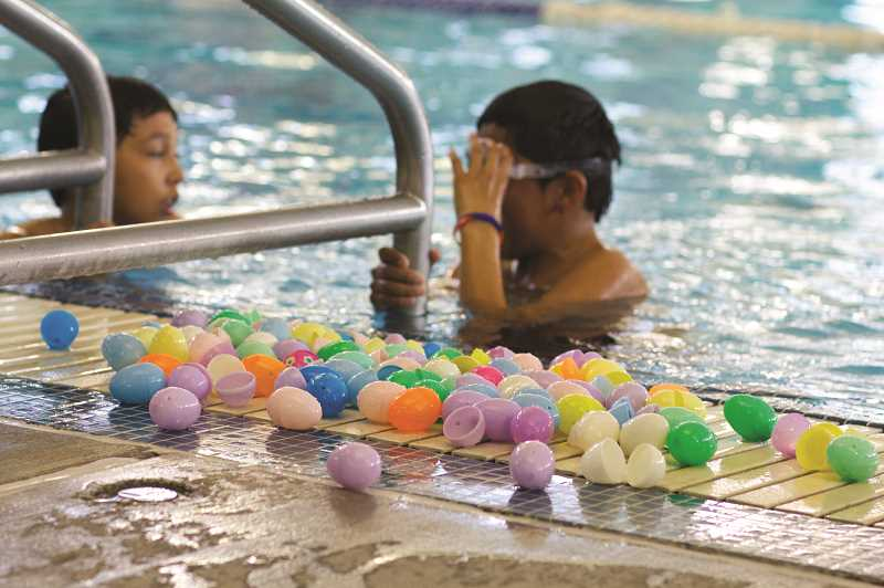 PMG FILE PHOTO - The Woodburn Aquatic Center's underwater Easter egg hunt lets experienced swimmers dive for eggs, while younger hunters can pluck floating eggs off the top of the water.