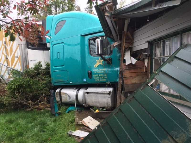COURTESY OF WOODBURN FIRE DISTRICT - A Food Services of America truck left the road and crashed into row houses in Hubbard on Monday afternoon, April 15. No one was injured.
