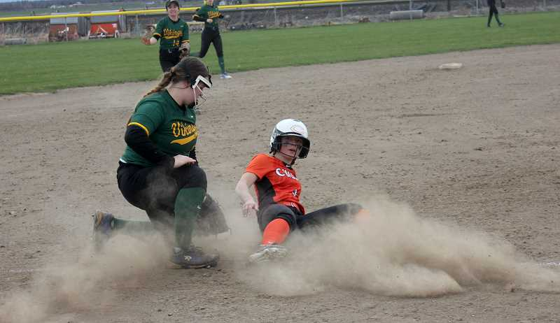 DESIREE BERGSTROM - Kinzi Jengels slides into third base to secure a triple in the Lady Dawgs' game against Colton April 12.