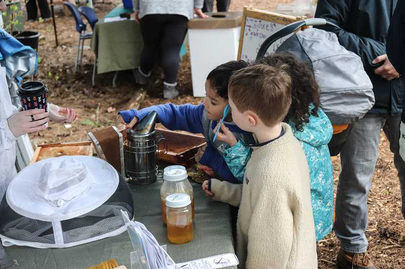 COURTESY PHOTO: ANDREW KILSTROM - Community members sample honey at the CREST Spring Celebration.