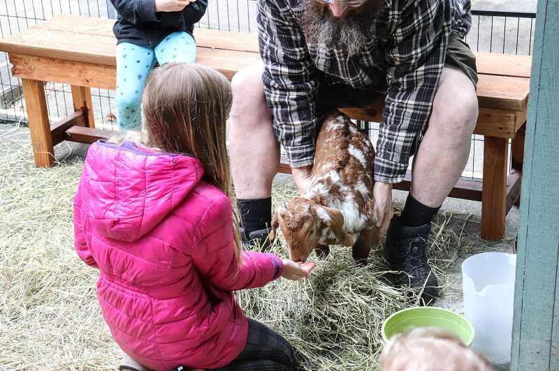 COURTESY PHOTO: ANDREW KILSTROM - Children enjoy playing with live animals at the CREST celebration April 13.