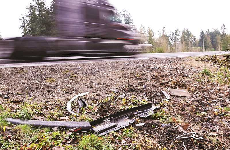 PMG FILE PHOTO - Debris remains on McKay Road after a two-vehicle collision in early April took the lives of three individuals.
