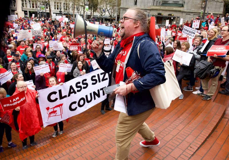 PMG PHOTO: JAIME VALDEZ - Joseph Vermeire, a teacher in Hillsboro, leads a crowd of teachers and school employees in a chant  during a rally in downtown Portland on April 10. Teachers are planning to rally again on May 8, this time in a walkout that will shut down Portland schools for the day.
